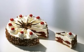 Black Forest cherry gateau, one piece cut out