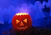 Pumpkin lantern for Halloween on straw