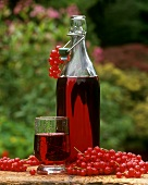 Redcurrant juice in bottle and glass