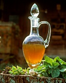 Mint syrup in a glass carafe