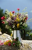 Bunch of wild herbs in a metal jug
