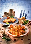 Shrimps in saffron sauce and breaded fish fillets