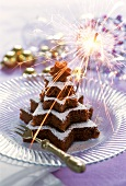Fir tree-shaped chocolate & nut cake made from star shapes