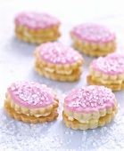 Sandwich biscuits with pink icing