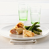 Crêpes with salmon filling and green asparagus