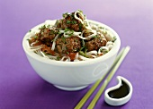 Meatballs with coriander on rice noodles