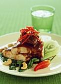 Chicken breast with tamarind sauce & cashew nuts on pak choi