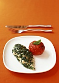 Chicken breast with herb sauce and baked tomato