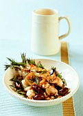 Squid and shrimp kebabs with rosemary and olives