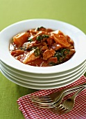 Pork goulash with potatoes and spinach