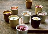 Various soups in beakers