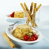 Cheese soufflé, mustard sauce, cocktail tomatoes & sesame sticks