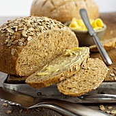 Wholemeal bread, slices cut, one slice with butter