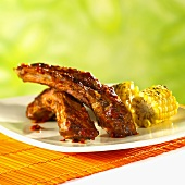 Barbecued beef ribs with corncobs