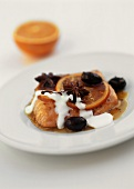 Salmon in orange butter with star anise and black olives
