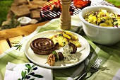 Sausage coil and meat kebab with potato salad