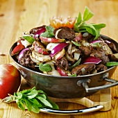 Pan-cooked chicken liver dish with apples and onions