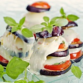 Aubergine and mozzarella tower with tomatoes and basil