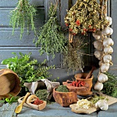 Still life with dried and fresh herbs and garlic