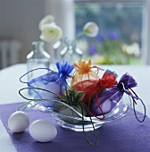 White eggs in coloured sacks as Easter decoration