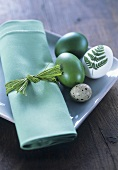 Plate with green fabric napkin and Easter eggs