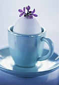 White egg in blue cup