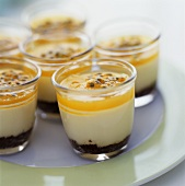 Cheesecakes with passion fruit in glasses