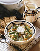 Vegetable stew with ceps, pearl barley and sour cream
