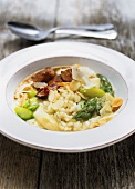 Asparagus and almond risotto with marinated chicken pieces