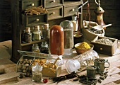 Still life with spices, old scales and spice cabinet