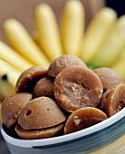 Palm sugar, bananas in background