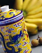Tea caddy with Chinese motif, bananas in background