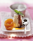 Quark soufflé with apricots and chocolate sauce