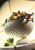 Mixed vegetables in a colander