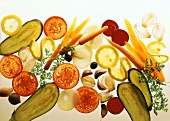 Translucent vegetable slices on sheet of glass