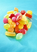 Colourful fruit gums on turquoise background