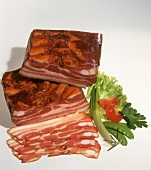 Smoked pork belly bacon, a slice cut