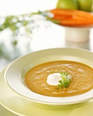 Creamed carrot soup with a blob of sour cream