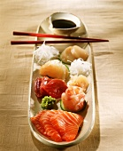 Sashimi (pieces of raw fish which are dipped in soy sauce)