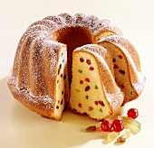 Ring cake with candied fruit, a piece cut
