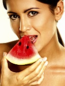 Woman with a piece of watermelon