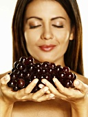Woman holding red grapes