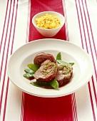 Leg of lamb with ramsons pesto stuffing, mangetout,saffron rice