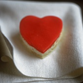 Heart-shaped sponge cake with red icing