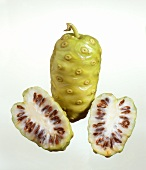 Whole and halved noni