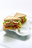 Double-decker sausage and salad sandwiches
