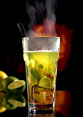 Hot caipirinha in glass (winter drink)