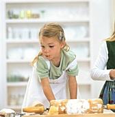 Small girl baking