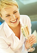 Blond woman holding glass of champagne