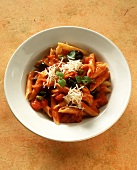 Penne alla puttanesca (Penne with tomatoes, capers, olives)